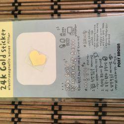 Αυτοκόλλητο χρυσό 24Κ σε τηλέφωνο από δώρο ακτινοβολίας