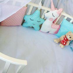 Sides with a unicorn crib