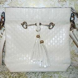 The bag is female white. Good condition.