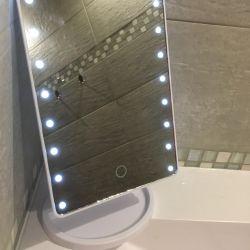 Desk mirror with illumination