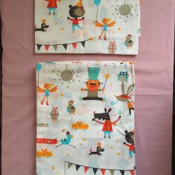 Children's bed linen in the playpen