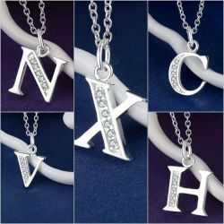The letter on the chain. Silver plated.