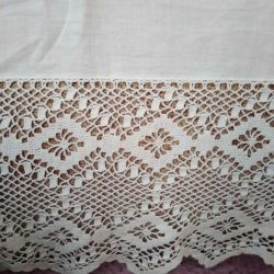 Vintage valance on the bed