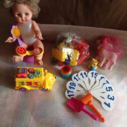 Doll with toys pack.