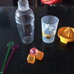 Juicer, cocktail glass, sticks, spoon