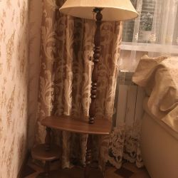 Floor lamp on a wooden stand
