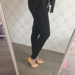 штани нові