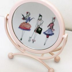 Foldable mirror makeup on a stand.