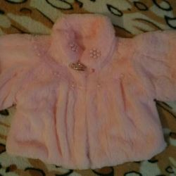 Children's fur coat with a short sleeve.