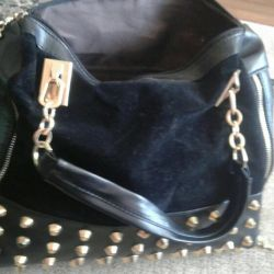 Bag used a couple of times in excellent condition. 39 * 27.