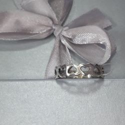 The ring is made of 925 silver. Heart.