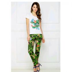 New narrowed trousers with a tropical pattern