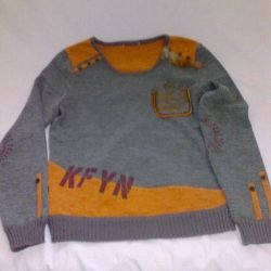 Gray sweater with orange inserts.