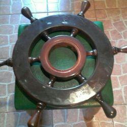 Steering wheel. A tree of oak.