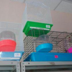 Клітки для птахів, поїлки, купалки