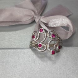 The ring is made of 925 sterling silver. Size 18