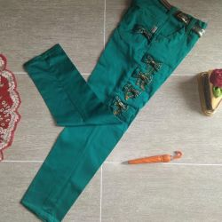 Trousers are turquoise. Maroon