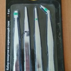 A set of tweezers for precise fur work.