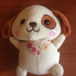 A dog, a soft toy