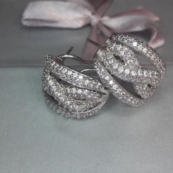 Earrings are made of silver 925 pr. Stones Zircons
