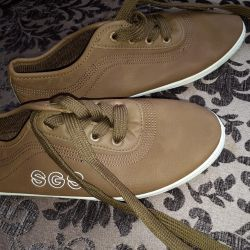 Sneakers from leatherette. New