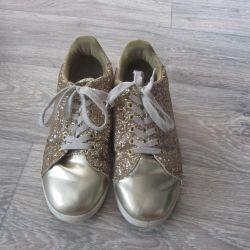 Golden sneakers boots