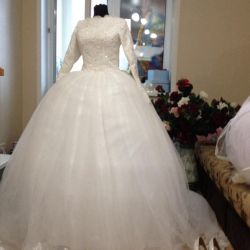 Wedding dress closed under the hijab with a long boot