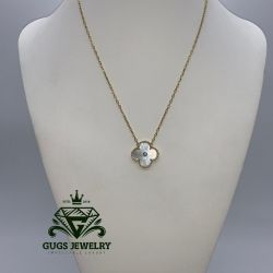 Van cleef & arpels gold pendant with shales.