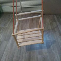 Wooden swing. The state of the new.