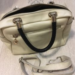 Leather bag of milk color