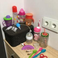 Bottles, cups and a heated plate