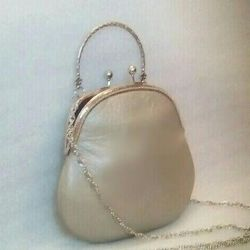 Small beige leather handbag