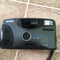 Η φωτογραφική μηχανή με θήκη εργασίας