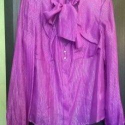 Women's blouse is new silky. RR 42-46
