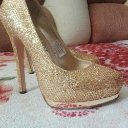 Pantofi de aur noi, Germania.