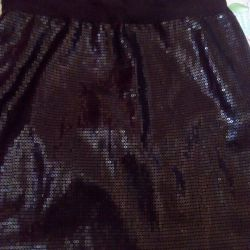 Skirt with a gloss effect of 30 cm.