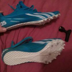 Running adidas spike sneakers