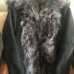 Sheepskin coat with raccoon fur