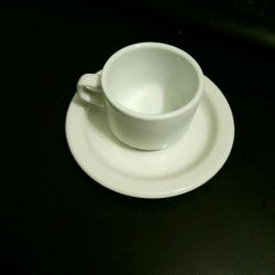 Coffee couple, a cup of coffee under the espresso with saucers