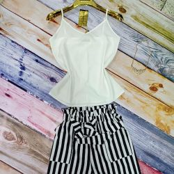 Suit a white top and black striped shorts. art 01