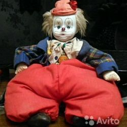 Clown with a porcelain head.