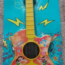 Toy guitar. New