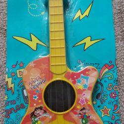 Іграшкова гітара. Нова