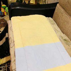 children's mattress in the crib