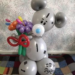 Teddy bear with flowers from balloons