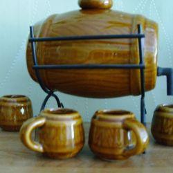 Souvenir beer keg with four mugs.
