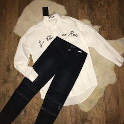 Новая женская рубашка и джинсы