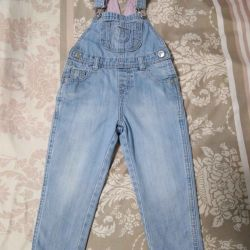 Overalls jeans on the girl