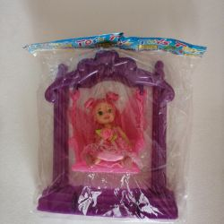 Doll on rocker toy
