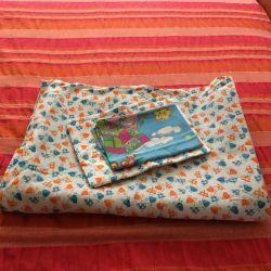 Woolen blanket with a set of linen